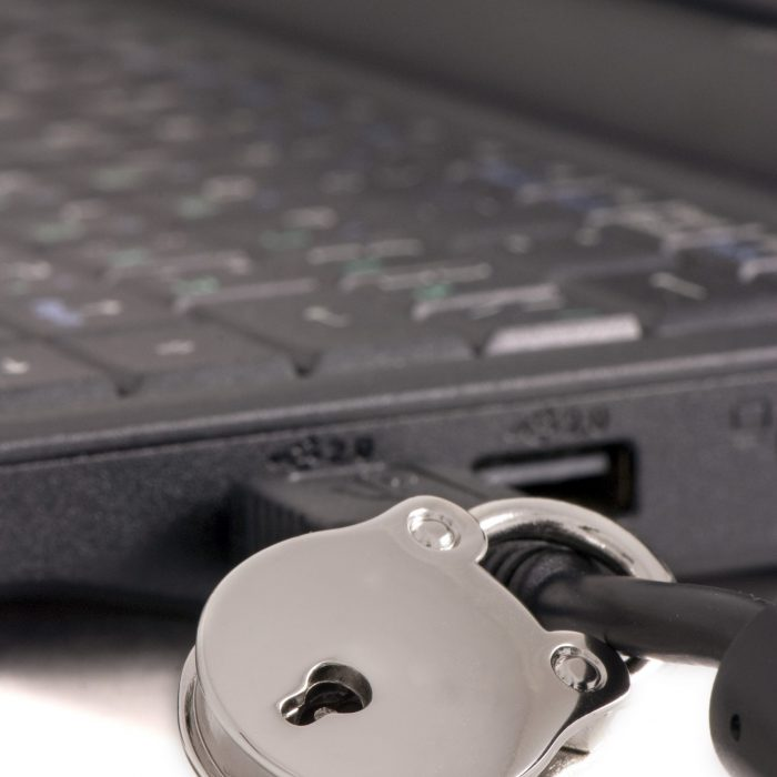 Padlock on a usb cable connected to computer